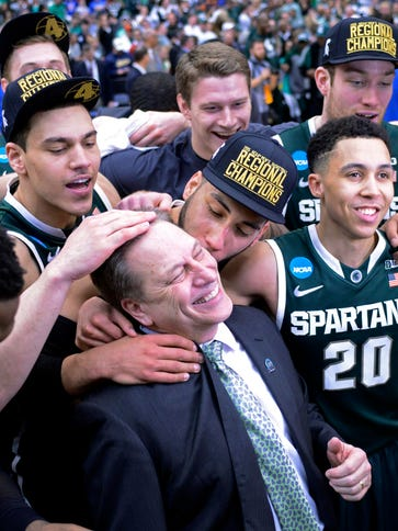 Michigan State coach Tom Izzo and the Spartans celebrate