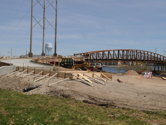The latest part of Oshkosh's river walk is under construction next to the railroad fishing pier on Michigan Avenue. Gov. Scott Walker's proposed budget calls for the elimination of Knowles-Nelson Stewardship funds. The city has relied heavily on these funds for construction of the river walk, receiving $1.7 million for the three segments that have been built already.