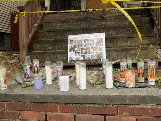 The makeshift memorial on the front steps of 315 Church St., which was the scene of a fatal fire on Monday.