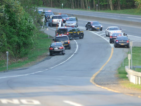 Police lined up on the exit for Route 9D on Interstate