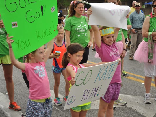 About 100 girls and their running buddies participated in the Girls on The Run 5K on Saturday.