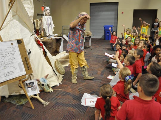 "Around 400 students visited the Paragon Casino Resort in Marksville on Friday for a sample of the annual Tunica-Biloxi Pow Wow. Tom ""Strong Buffalo"" Varnado talks to students about Indian customs and traditions during the field trip opportunity offered by the Pow Wow committee."