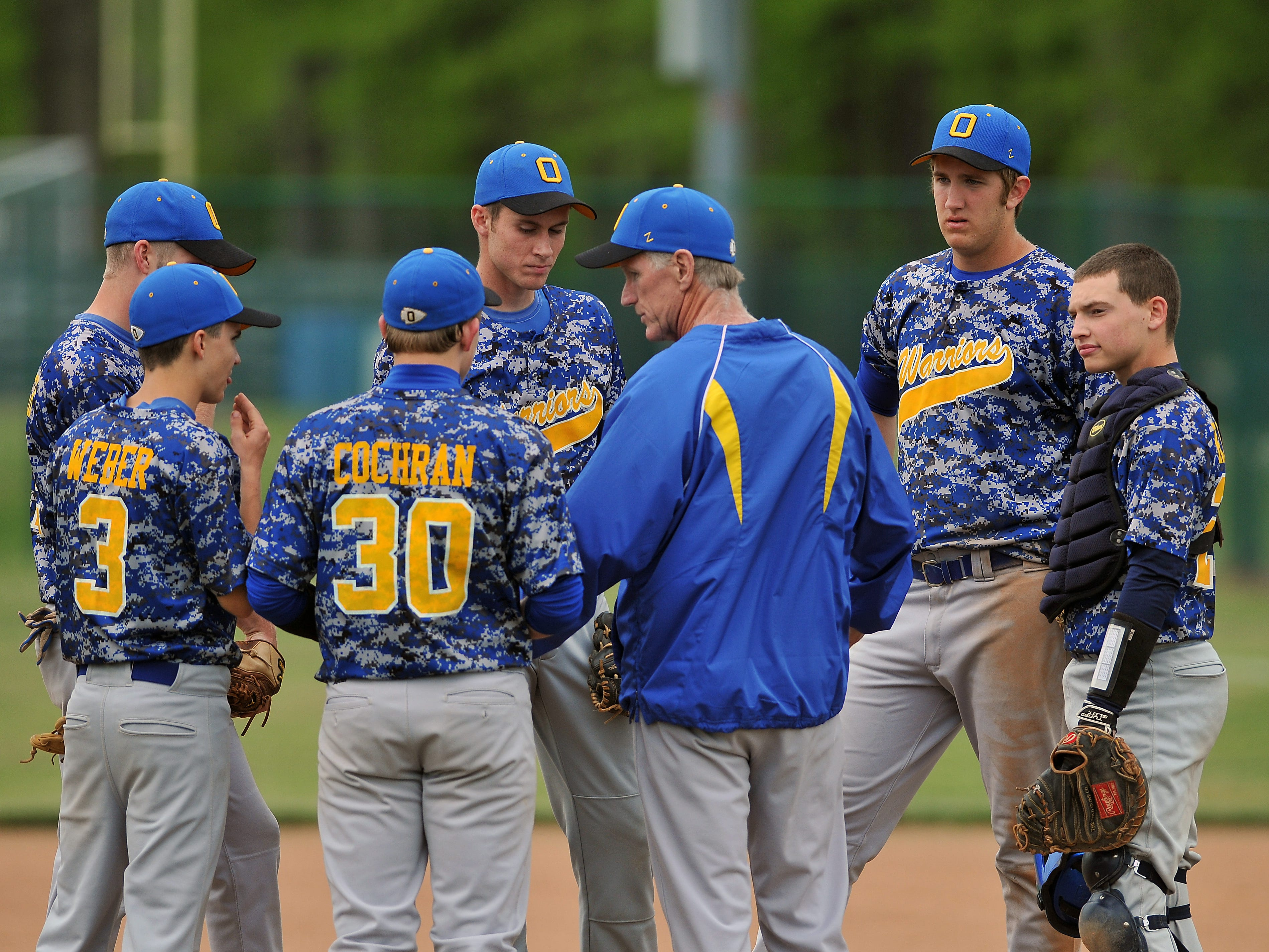 Ontario baseball coach Dan Gorbett meets with his team during Thursday's 7-2 sectional final win over Galion. The top-seeded Warriors will play Shelby Thursday afternoon at Madison in a Division II district semifinal game.