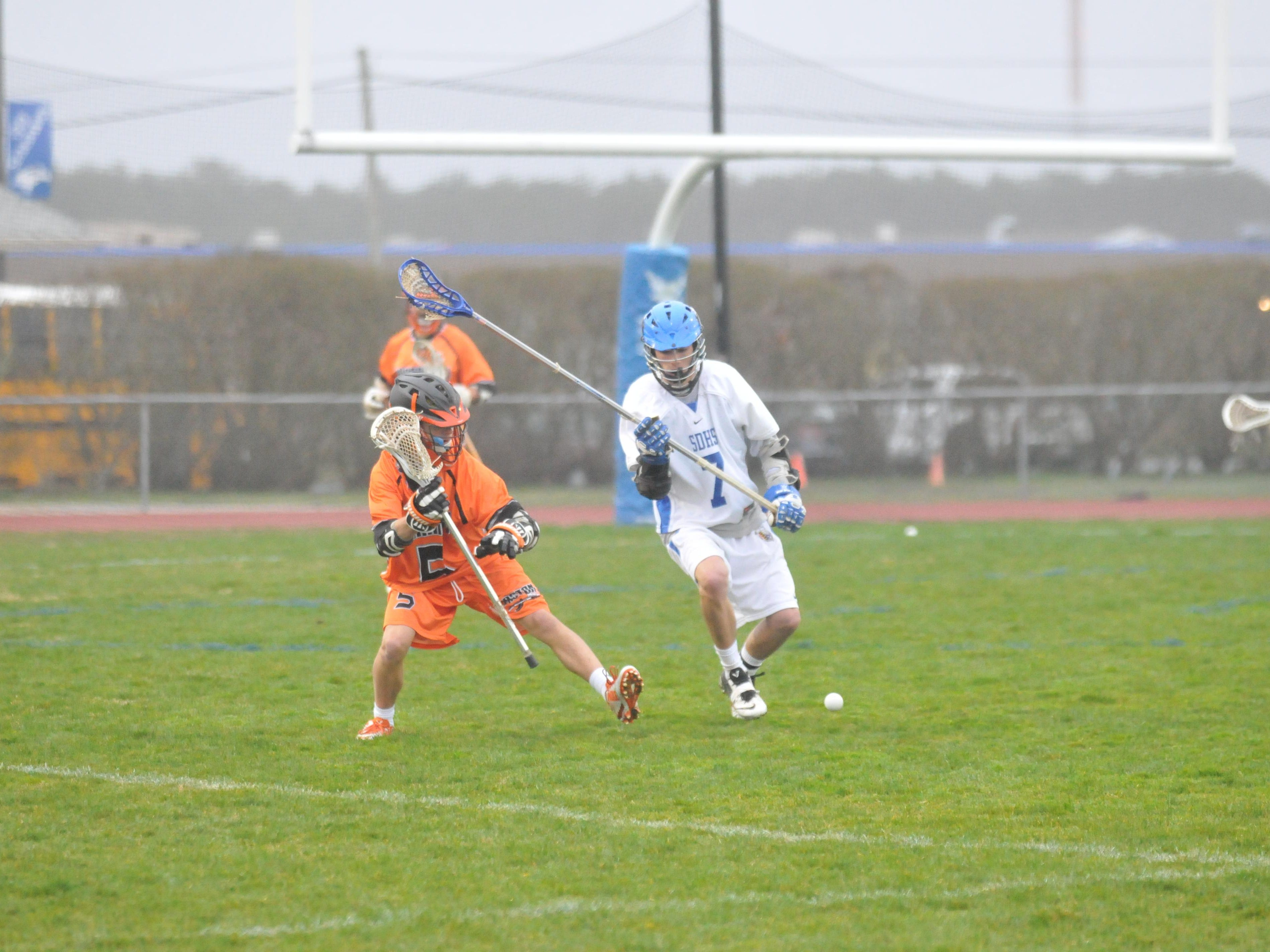 Stephen Decatur's Craig Snyder knocks a ball away from an Easton player.
