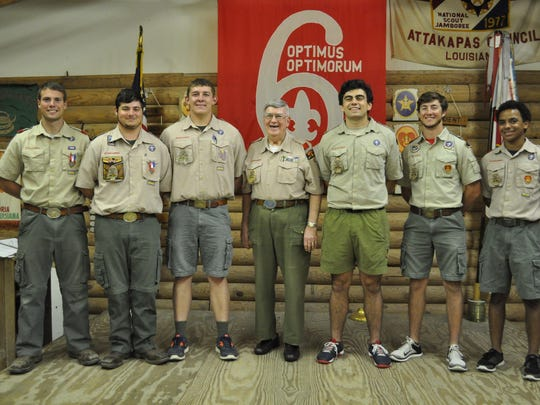 (From left to right) Michael Smilie, Hunter Wellan,Wyatt Thiels, Thomas Davis, Grant Dobard and Lee Jones stand with Scoutmaster Emile Oestricher (center). The group along with two other buddies graduated from Holy Savior Menard High School last month, a second major milestone for them to accomplish together. The eight also achieved the rank of Eagle Scout as members of Troop 6 in Alexandria.