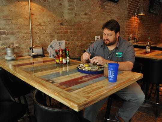 Ducote enjoys a meal from Jolie Pearl's Oyster Bar
