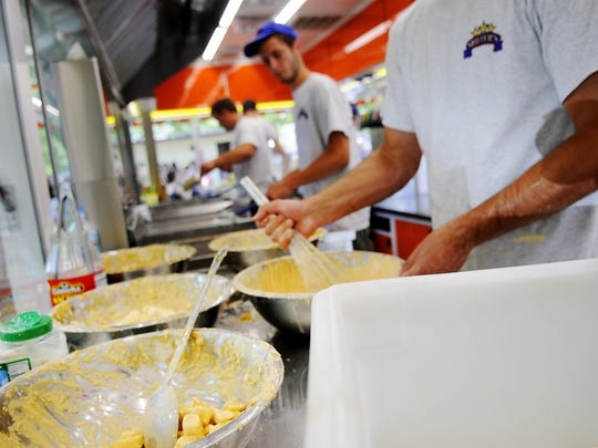 Cheese curds are tossed in batter, ready to fry, in Rob Miller's new cheese curd trailer at the Sauk Rapids Food Fest on Saturday.