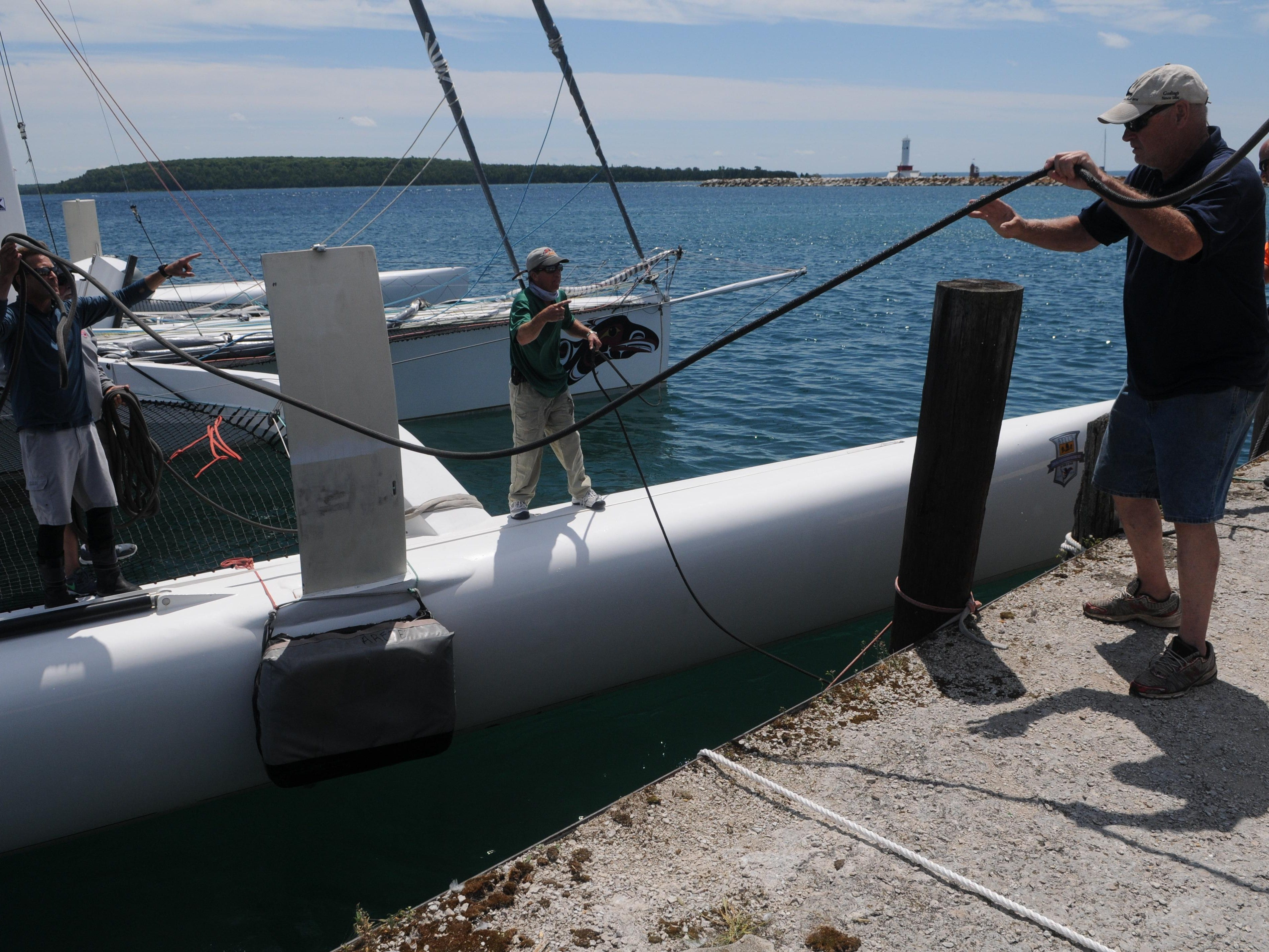 The crew of Arete docks on the Arnold Dock Sunday after finishing of the Port Huron-to-Mackinac Island Sailboat Race.