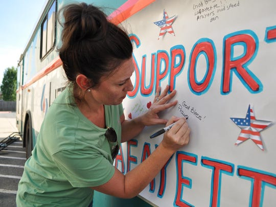 Jessica Butler signs a message from her family to the Lafayette community.