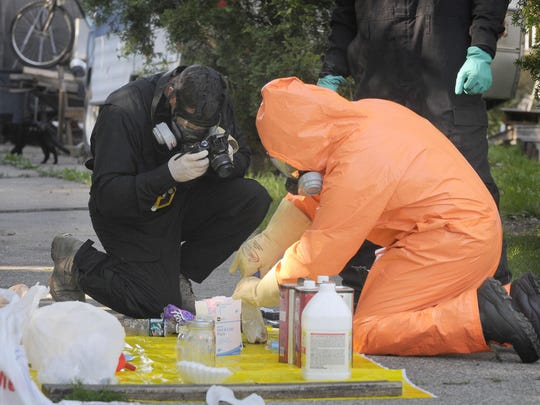 St. Clair County Drug Task Force and Port Huron Police go through items from a suspected meth lab Friday morning, July 24, on Varney in Port Huron.