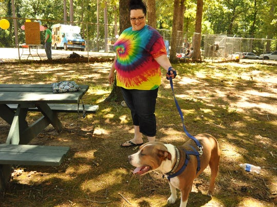 Stephanie Stiles with her dog Butch after he was washed at the P.A.W.S. Animal Shelter fundraiser.