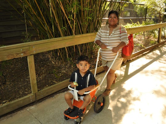 Liz Lopez and her son Cesar enjoy free admission to The Alexandria Zoo on Saturday.