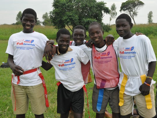 Ugandan orphans learn about the camaraderie football