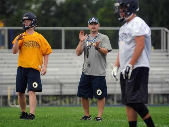 Head coach Larry Roelens works with his receivers Monday, Aug 10, during the first day of football practice at Port Huron Northern.