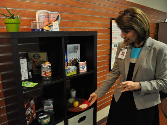 Pam Jones, a clinical dietician, shows off her cubicle and teaching tools on Thursday inside the the new Healthy Learning Center at Christus St. Frances Cabrini Hospital.