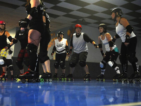 The SCAR (St. Cloud Area Roller) Dolls run scrimmages at Skatin' Place in this Times photo.