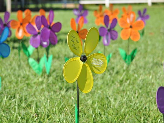 """Promise flowers"" decorate the Kent Plantation House yard."