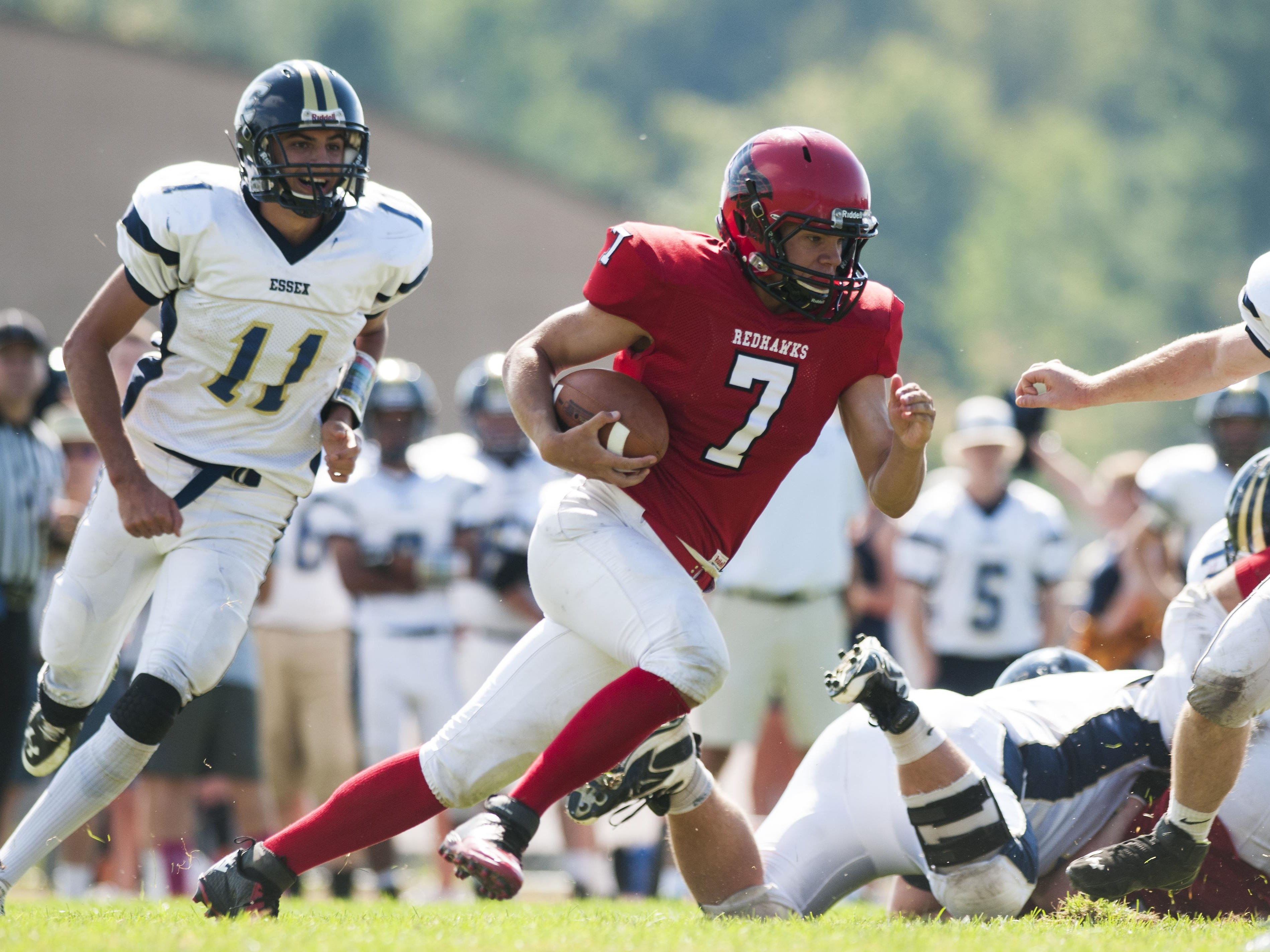 CVU quarterback Andrew Bortnick runs with the ball during a high school football against Essex in Hinesburg on Saturday.