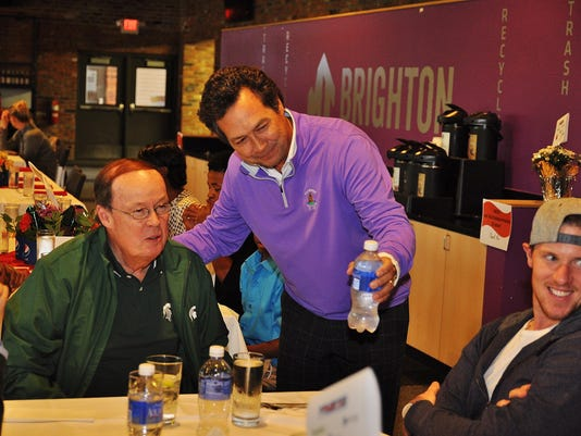 RAK founder Tim Codd with Pistons announcer George Blaha and Wings goalie Ji
