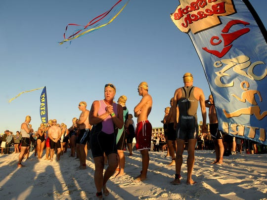 Triathletes get ready to hit the water in 2011 during the Santa Rosa Island Triathlon at Pensacola Beach.