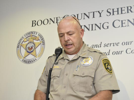 Boone County Sheriff Mike Moore answers questions Monday, Oct. 5, 2015 during a press conference regarding the double murder of Helen Froehlich and and Frank Simpson. Froehlich's husband, Albert Froehlich, has filed a lawsuit against the sheriff in connection with her death.