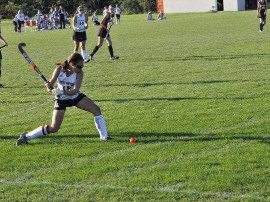 South Western's Holly Martin passes the ball up to her teammates.