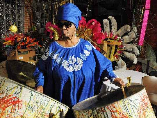"""Regina Lawson, 66, of Detroit, loves everything about the Caribbean, especially the music. """"It makes me feel like I'm in the islands, especially on a cold day,"""" she says. Lawson played in Sorzano and Taylor's original steel drum band, the Caribbean Pans of Joy."""