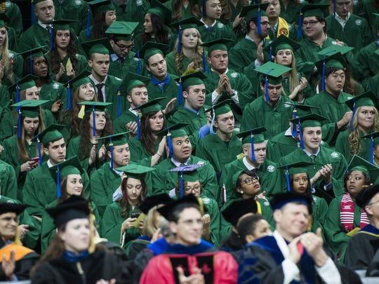 MSU faculty and staff applaud during Fall 2015 commencement ceremony.