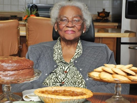 Mary Alice Sain with her Devil's Food Cake, Pecan Pie and Brown Sugar Cookies