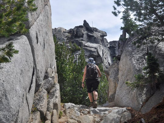 A trail passes through granite to The Lakes Observation Point.
