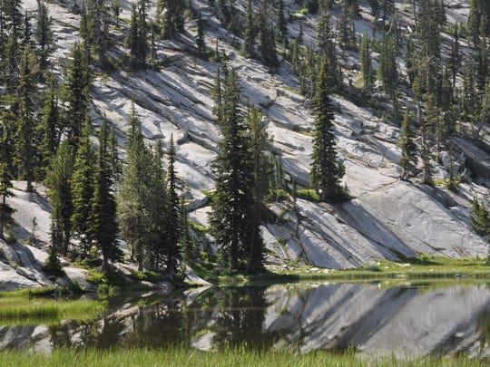 Granite is reflected in Hoffer Lakes.