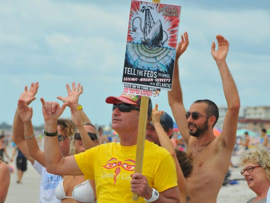 """Terry Bernard was one of about 75 people attending a January """"Hands Across the Sand"""" event at Lori Wilson Park in Cocoa Beach. He and others took a stand against offshore drilling and offshore seismic testing."""