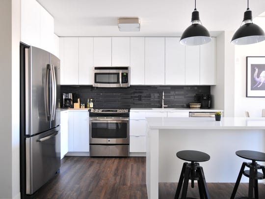 This kitchen features easy-care hardwood flooring and non-staining quartz countertops — great solutions for the simplified lifestyle millennials prefer.