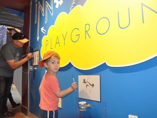Visitors to ECHO's Innovation Playground exhibit.