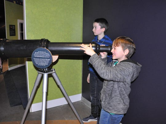 """A telescope at the """"My Sky"""" exhibit."""