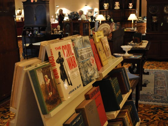 """Ed and Virginia Pettis came from West Monroe to the """"So Rare"""" antique show. The couple said they like old books and furniture and brought plenty of it with them to Pineville."""