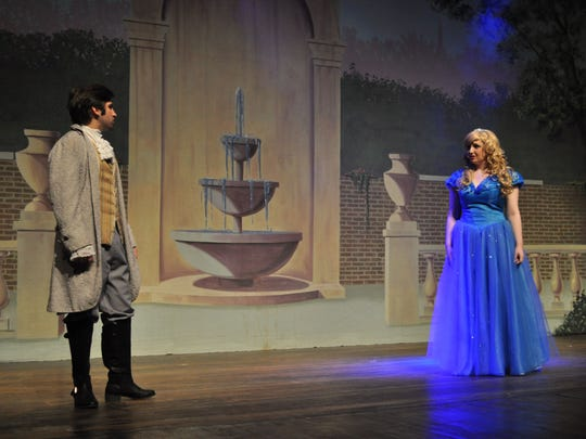 Shira Kaplan, as Cinderella, rehearses with Bryan Deloach, the prince, during a practice for Pineville High School Theatre's production of Rodgers and Hammerstein's Cinderella. The show opens Thursday and runs through Sunday.