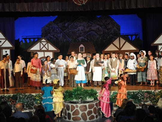 Students from the Sampson G. Smith School perform scenes from Beauty & the Beast, which ran from Jan. 30 to Feb. 1 and Feb. 6 to 8. The show is led by Theresa Seggio, who established the school's flourishing drama program 10 years ago.