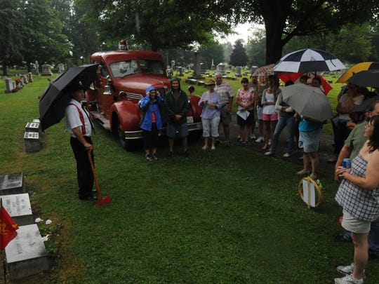 Tim Musselman portrayed fire Chief William Mader during the Bucyrus Cemetery Walk at Oakwood Cemetery on Sunday.