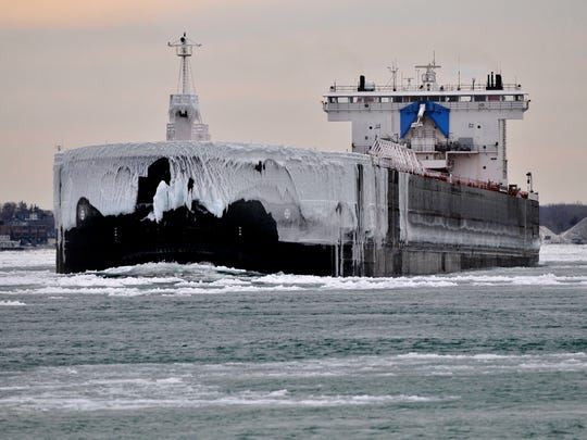 The iced-covered Walter J. McCarthy Jr. travels up the St. Clair River into Lake Huron Thursday on its way to Lake Superior.