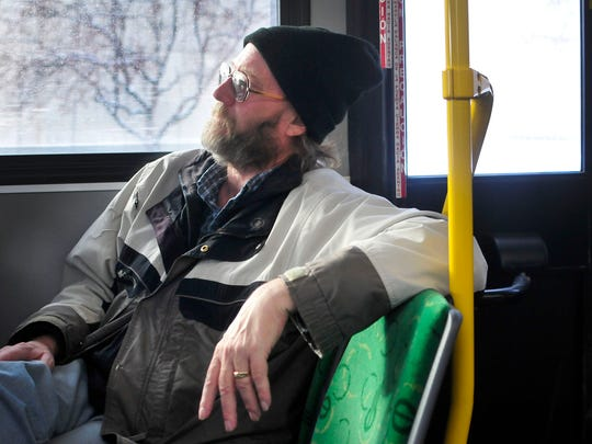 """Chris Dekorver rides a Silver Line bus in Grand Rapids. He said the system is """"much more reliable"""" than the previous service."""