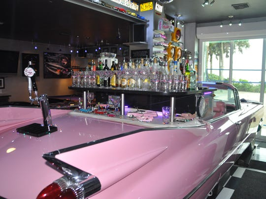 A 1959 pink Cadillac doubles as a mini bar.