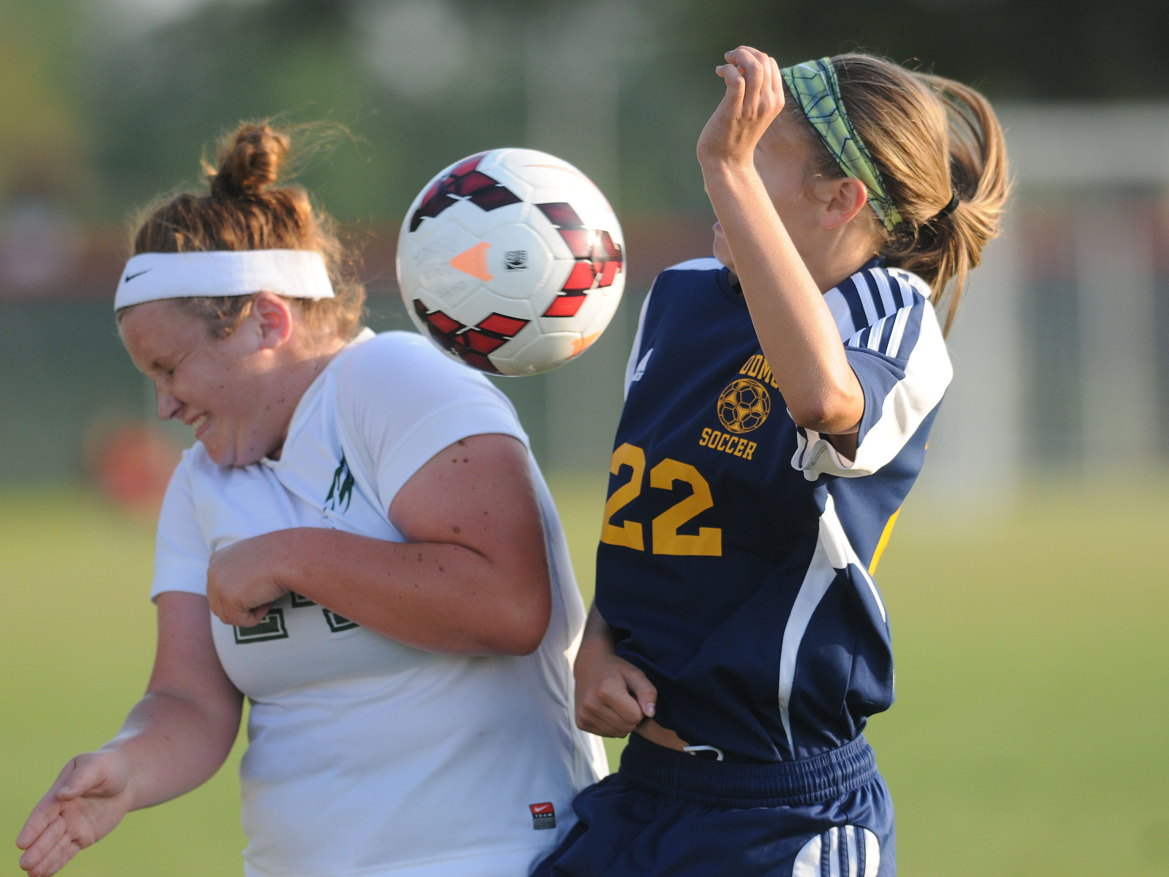 Oak Harbor's Ally Croy and Woodmore's Liz Koenig fight for the ball during a soccer game on Monday, Aug 18, 2014.