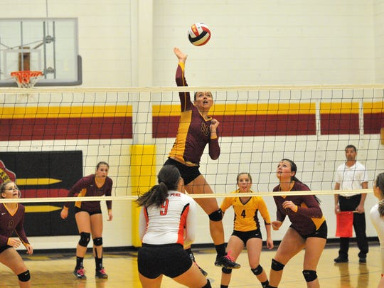 L-C Spartan Haley Yagodinski hitting a kill against West De Pere in regional action, as LC swept the Phantoms in three games.