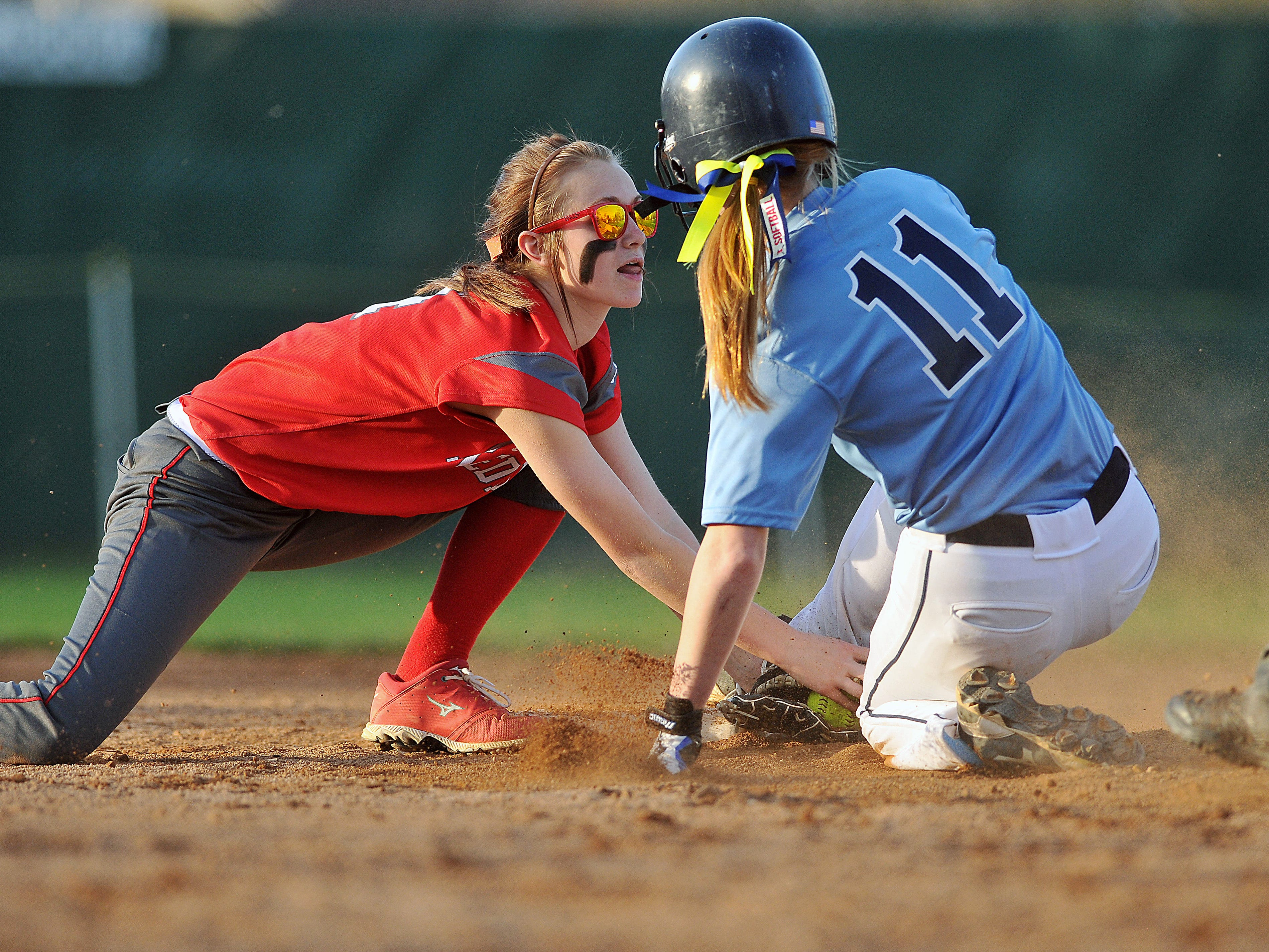 Hillsdale's Adrianna Rogers slides into second against Loudonville during the Wendy's Spring Classic at Brookside Park Friday.