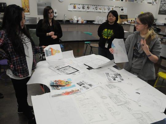 Oshkosh North students and advisors show off some of