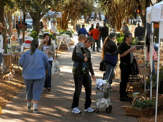 People shop at the Palafox Market, which is open 4 to 7 p.m. Wednesdays and 8 a.m. to 2 p.m. Saturdays at the Martin Luther King Jr. Plaza.