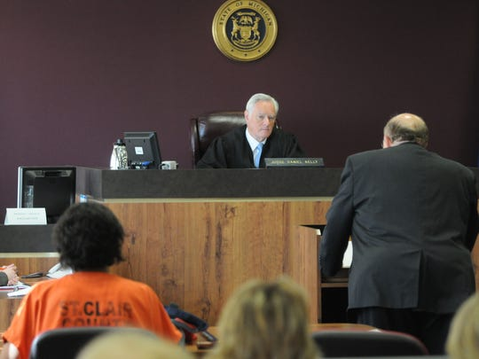 Judge Daniel Kelly listens to arguments by lawyer John Livesay during Tia Skinner's re-sentencing in July 2013.