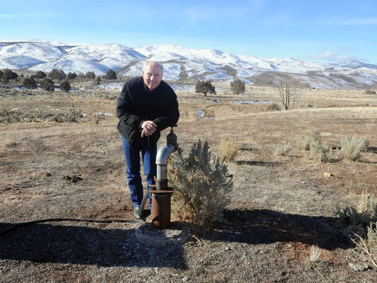 Bob Marshall with the well in Dry Valley he calls Dead Coyote Well Wednesday Feb. 5, 2014.