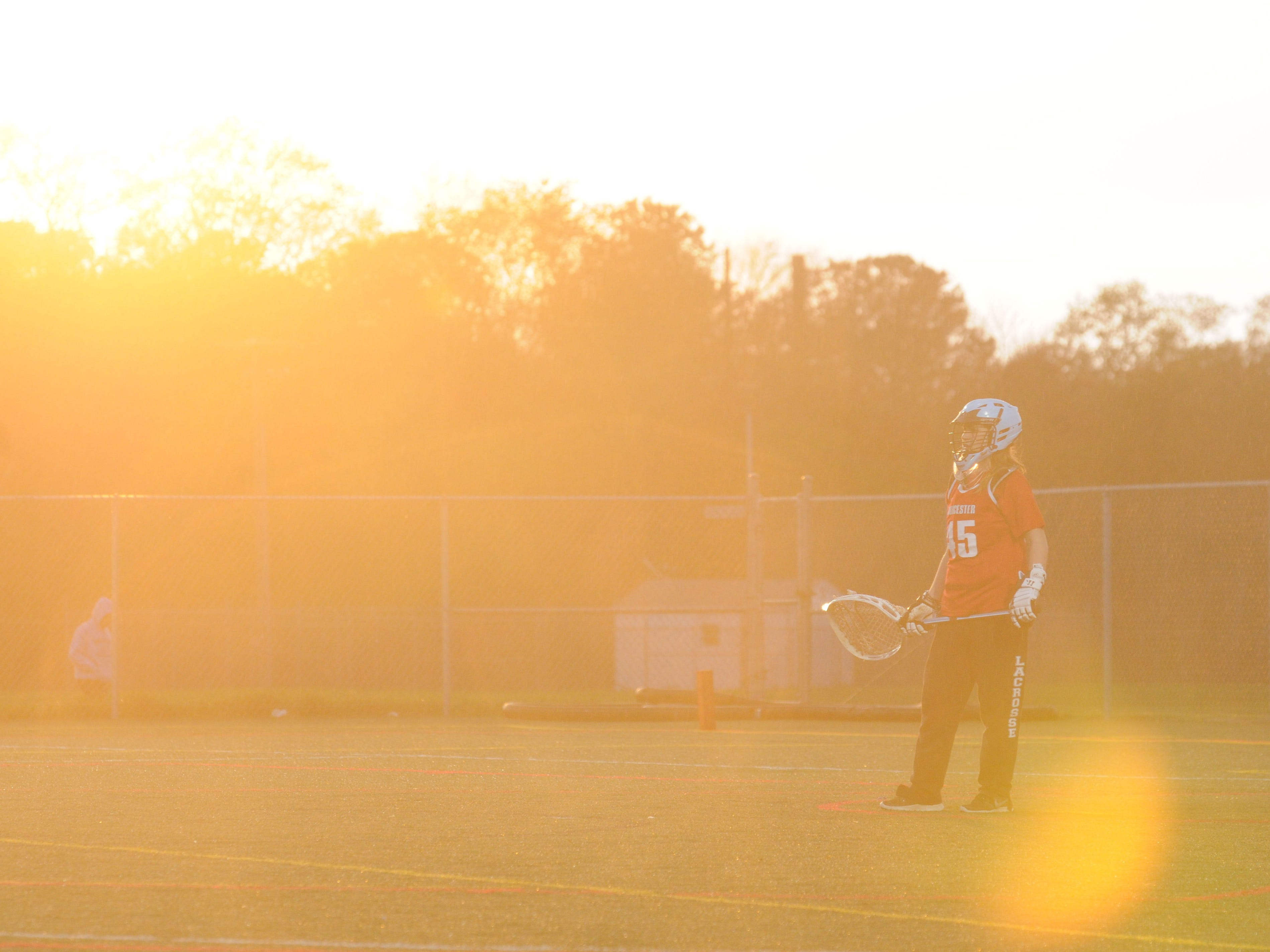 The sun sets through the misty rain as the Worcester Prep goalie Carolyn Dorey watches play at Cape Henlopen as the Vikings took on the Mallards.